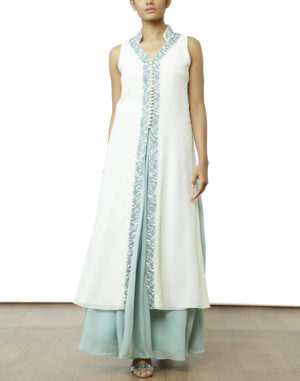 Cream paneled tunic with blue resham and white beads embroidered on to the collar, neckline and center front of the tunic, paired with a powder blue gathered skirt.