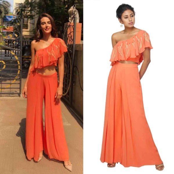 Mandana Karimi in Orange Crop Top & Pleated Pants
